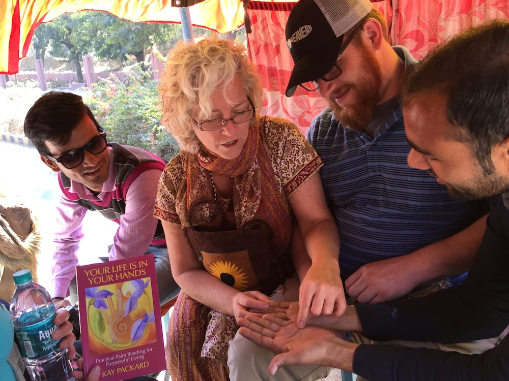 Kay reading Taj guides hands